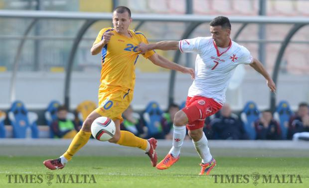 Malta's Clayton Failla (right) tries to make his way past Moldova's Eugeniu Sidorenco during an International friendly match at the National Stadium in Ta'Qali on March 24. Photo: Matthew Mirabelli