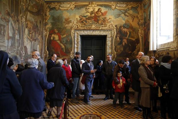Members of the public queue up to exchange greetings with Malta's bishops at the Curia in Floriana on December 28. Photo: Darrin Zammit Lupi