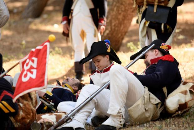 A man and young boy rest during a battle re-enactment held in San Maison on June 5. Photo: Mark Zammit Cordina