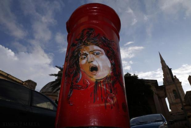Parisian street artist Christian Guemy- better known as C215 and often referred to as France's response to Banksy – has left a trail of art pieces inspired by the ghost of Caravaggio on pillar boxes. Pictured is his Medusa in Valletta on October 27. Photo: Darrin Zammit Lupi