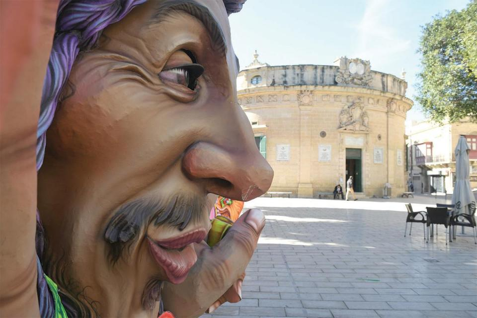 A carnival figure watches over an otherwise empty square in Victoria. Photo: Matthew Mirabelli