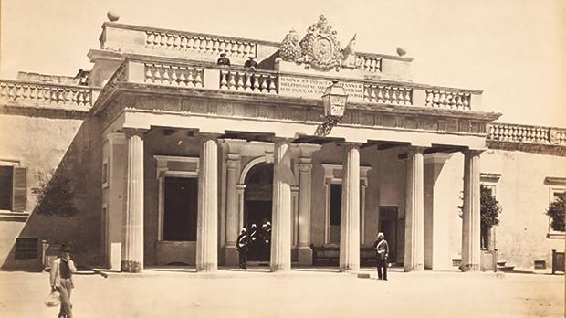 The Main Guard in the 1870s, after the Royal Arms were reconstructed, and showing the first electric clock in Malta.