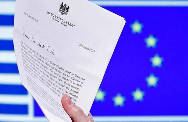 EU Council President Donald Tusk holds British Prime Minister Theresa May's Brexit letter in Brussels.