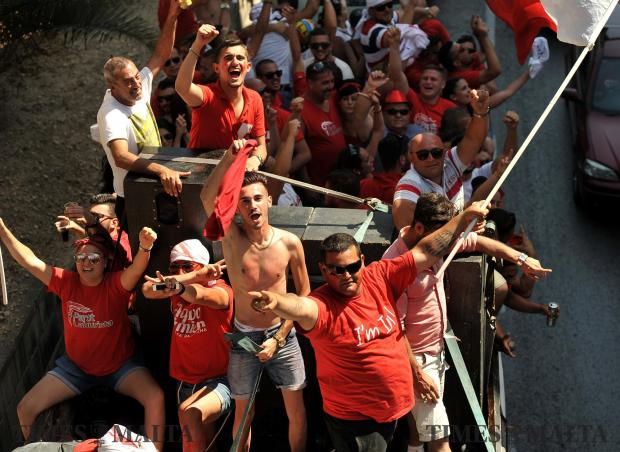 Labour supporters celebrate the PL victory at the polls by carcading on trucks on June 4. Photo: Chris Sant Fournier