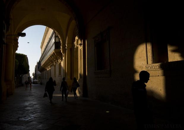 People walk through Old Theatre Street adjacent to the Grand Master's Palace in Valletta on June 1. Photo: Darrin Zammit Lupi