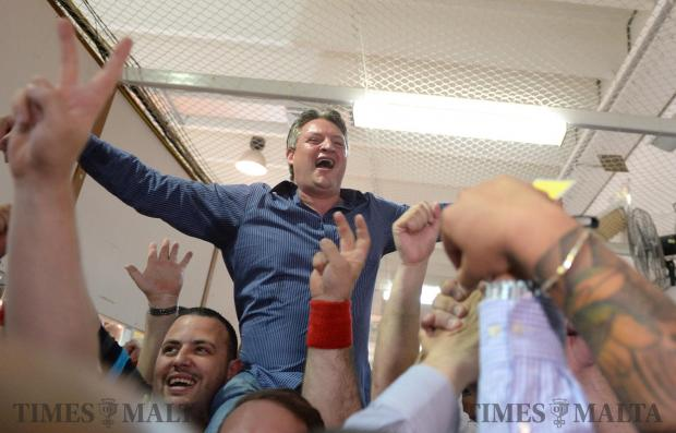 Konrad Mizzi celebrates in the counting hall in Naxxar after early indications point to another victory for the Malta Labour Party. Photo: Matthew Mirabelli