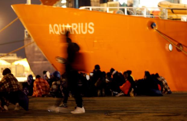 Migrants disembark from the MV Aquarius after its arrivalgen in Sicily in January.