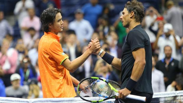 Rafael Nadal of Spain (right) shakes hands with Taro Daniel of Japan after their match.