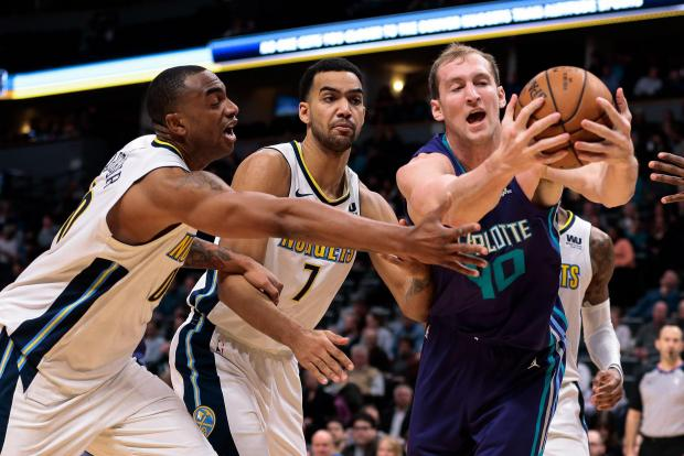 Charlotte Hornets center Cody Zeller (40) battles for a loose ball with Denver Nuggets forward Darrell Arthur (00) and forward Trey Lyles (7) in the fourth quarter at the Pepsi Center. Photo Credit: Isaiah J. Downing-USA TODAY Sports