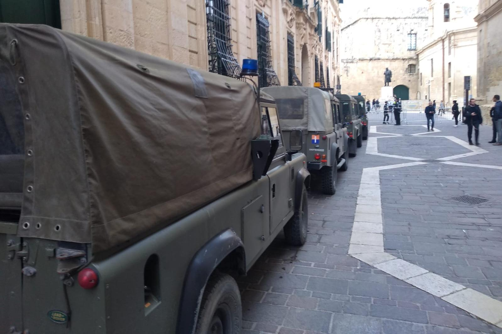 Army reinforcements were taken to the Auberge de Castille in a number of Land Rovers, seen here at the Merchants' Street entrance.