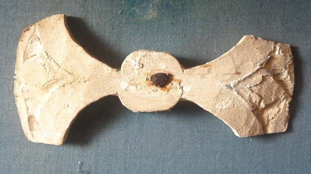 A small gilded wooden cross of Byzantine design.