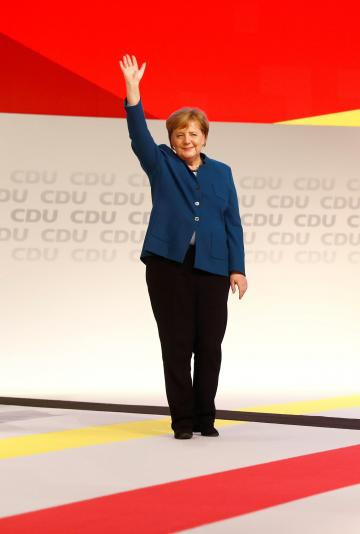 Ms Merkel waves to the crowd at her last CDU congress as party leader. Photo: Reuters