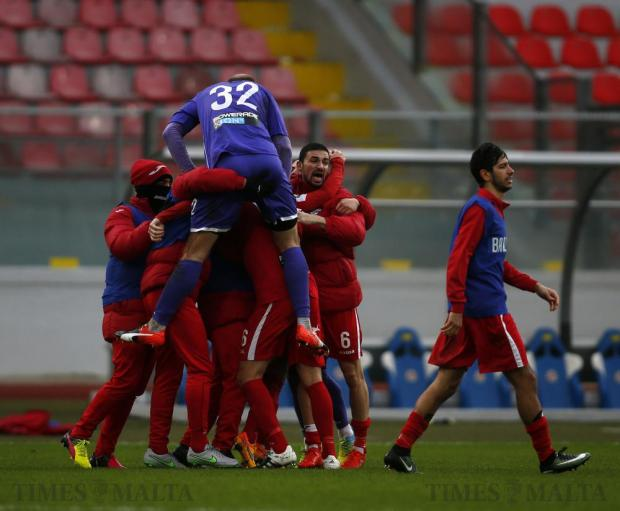 Balzan's players celebrate going to the top of the table after defeating Hibernians during their Premier League football match at the National Stadium in Ta'Qali on December 17. Photo: Darrin Zammit Lupi