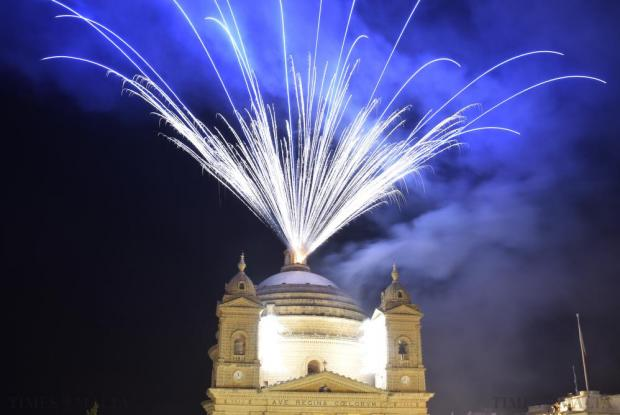 Fireworks light up the night sky above the Mgarr parish church during the feast of Our Lady of the Assumption on 22 August. Photo: Mark Zammit Cordina