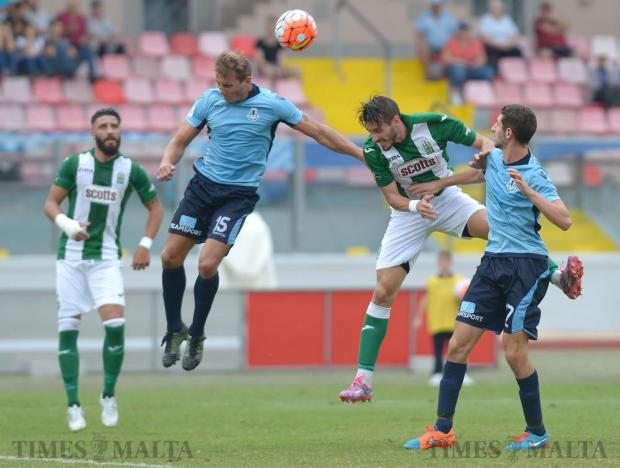 Sliema Wanderers' Marko Potezica (2nd left) and Floriana's Ignacio Varela vie for the ball during their Premier League match at the National Stadium in Ta' Qali on October 1. Photo: Matthew Mirabelli