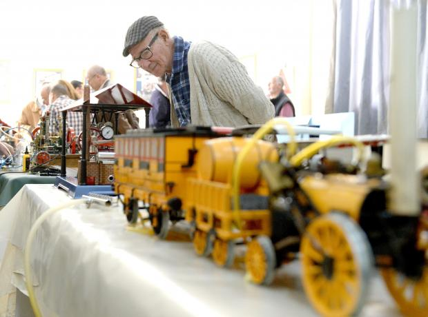 An old man admires a model steam engine at an exhibition held at the old railway station in Hamrun on January 28. Photo: Matthew Mirabelli