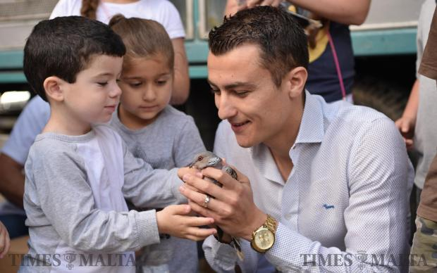 Labour Party Candidate Silvio Schembri holds a turtledove whilst a child pets it in Buskett during the release of around four hundred turtledoves by hunters on May 21. Photo: Mark Zammit Cordina