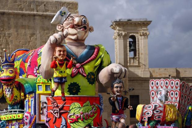 A satirical carnival float depicting Prime Minister Joseph Muscat and Opposition leader Simon Busuttil takes a part in a carnival parade at Castille Place in Valletta on February 7. Photo: Darrin Zammit Lupi