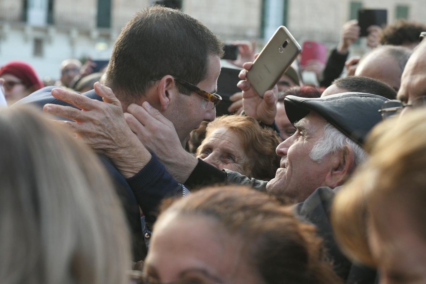 Smiles, hugs and selfies for Dr Abela. Photo: Matthew Mirabelli