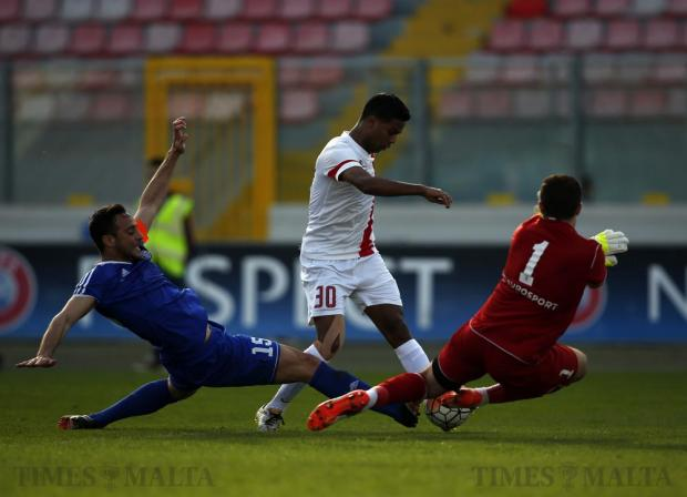 Mosta's Adrian Borg (left) and goalkeeper Yenz Cini (right) try to block Valletta's Abdelkarim Nafti during their Premier League football match at the National Stadium in Ta'Qali on March 20. Photo: Darrin Zammit Lupi
