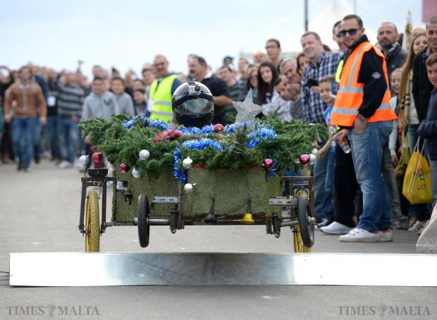 One of the entries in the soapbox competition takes off after going over the compulsory ramp during Paqpaqli Ghall-Istrina car show at Hal Farrug on December 7. Photo: Matthew Mirabelli