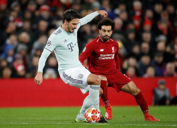 Bayern Munich's Mats Hummels in action with Liverpool's Mohamed Salah.