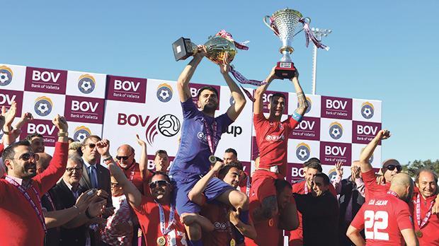 Victoria Hotspurs players lift the GFA Cup. Photo: Stefan Abela