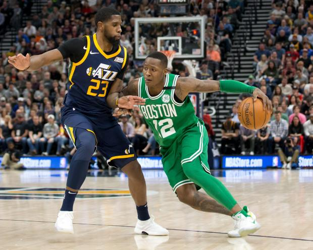 Boston Celtics guard Terry Rozier III (12) dribbles the ball against Utah Jazz forward Royce O'Neale (23) during the second half at Vivint Smart Home Arena. Photo Credit: Russ Isabella-USA TODAY Sports