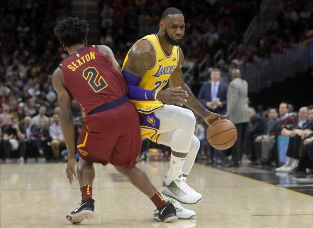 Cleveland Cavaliers guard Collin Sexton (2) defends Los Angeles Lakers  forward LeBron James ( 24f65414a