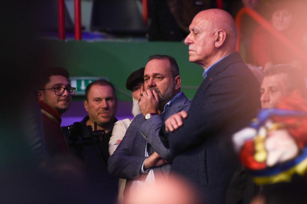A tearful Chris Cardona looks on from the sidelines.