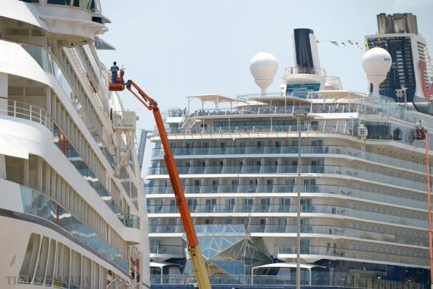 A worker cleans the windows of a cruise liner berthed in Valletta on July 5. Photo: Matthew Mirabelli
