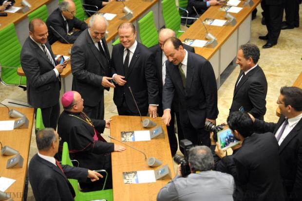 MPs share a laugh with Archbishop Charles Scicluna as they enter the chamber of the new Parliament at City Gate on May 4. Photo: Matthew Mirabelli
