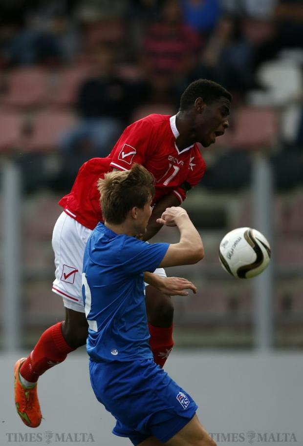 Malta's Kyrian Nwoko (top) and Iceland's Alfons Sampsted challenge for a high ball during their UEFA U-19 Championship football match at Hibs Stadium on November 15. Photo: Darrin Zammit Lupi