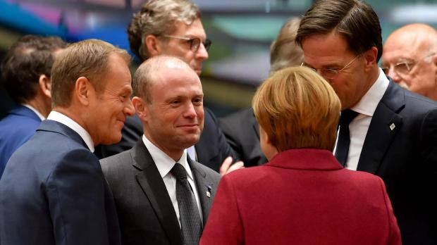 Dr Muscat speaks with Donald Tusk, Mark Rutte and Angela Merkel in Brussels. Photo: DOI/Jeremy Wonnacott