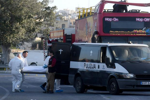 A police hearse waits to take the two foreigners who died on April 9 when a tourist double decker bus hit a tree in Zurrieq. Photo: Jonathan Borg