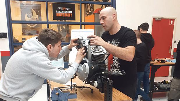 Jonathan Pandolfino (right) working on one of the Harley-Davidson engines.