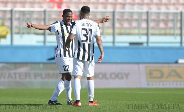 Hibernians' Gilmar (left) celebrates with teammate Diosado Mbele after scoring a goal during their BOV Premiership match against Mosta at the National Stadium in Ta'Qali on March 13. Photo: Matthew Mirabelli