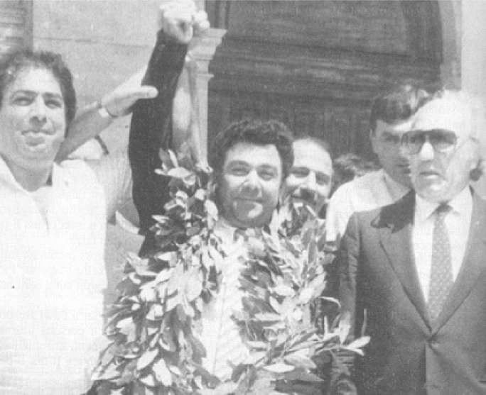 Pietru Pawl Busuttil celebrates after a court cleared him of all charges and confirmed that he was the victim of a frame-up.