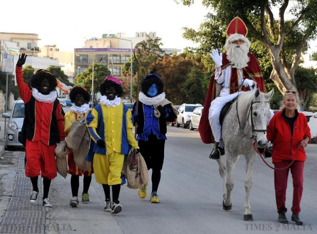 St Nicholas and four black Peters make their way to the Dutch ambassador's residence for a children's Christmas party on December 6. Photo: Chris Sant Fournier