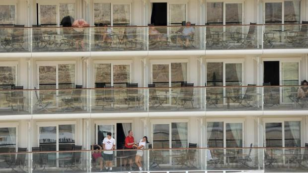 Passengers aboard the 'Celebrity Equinox' relax on their cabin balconies while berthed in Grand Harbour on August 3. Photo: Chris Sant Fournier