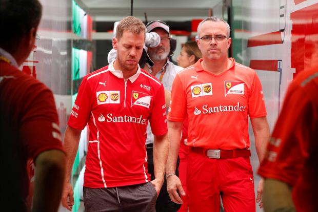 A distraught Sebastian Vettel leaves the Singapore circuit.