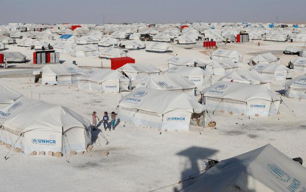 File photo: Children walk at a camp for people displaced from fighting in the Islamic State stronghold of Raqqa.