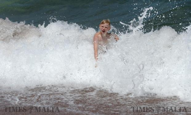 A young boy enjoys the rough sea in Bugibba on May 16. Photo: Matthew Mirabelli
