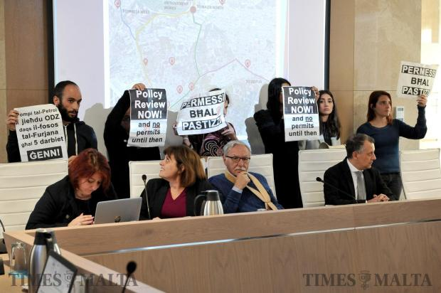 Graffitti activists storm a Planning Authority public hearing protesting against the transfer of a Sliema fuel station onto Luqa ODZ land on April 5. Photo: Chris Sant Fournier