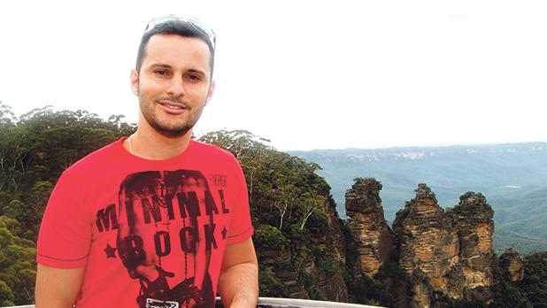 Kevin Cremona with The Three Sisters rock formation in the Blue Mountains, New South Wales – a couple of hours west of Sydney – in the background.