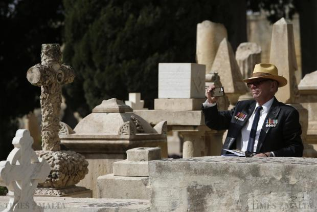 A military veteran takes a picture before a service to mark the 100th anniversary of ANZAC (Australian and New Zealand Army Corps) landings at Galllipoli, at the Pieta Military Cemetery in Pieta on April 25. The Gallipoli campaign has resonated through generations, which have mourned the thousands of soldiers from the ANZAC cut down by machinegun and artillery fire as they struggled ashore on a narrow beach. The fighting would eventually claim more than 130,000 lives, 87,000 of them on the side of the Ottoman Turks, who were allied with imperial Germany in World War One. Photo: Darrin Zammit Lupi