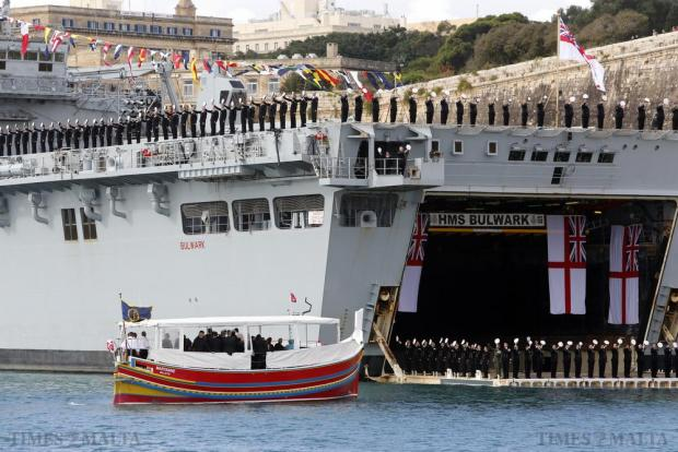British Royal Navy officers and sailors salute on HMS Bulwark as a boat carrying Britain's Queen Elizabeth passes in Valletta's Grand Harbour during the Commonwealth Heads of Government Meeting (CHOGM) on November 28. Photo: Darrin Zammit Lupi