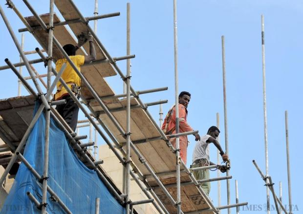 Construction workers assemble scaffolding in Valletta on October 29. Photo: Chris Sant Fournier