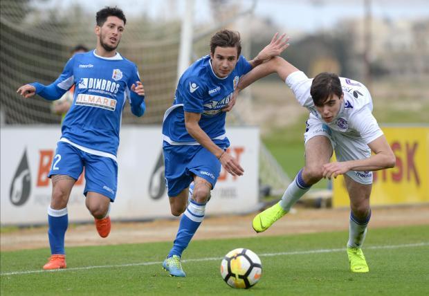 Juri Cisotti (left) of Mosta tries to move past St Andrews' Alex Satariano. Photo: Matthew Mirabelli
