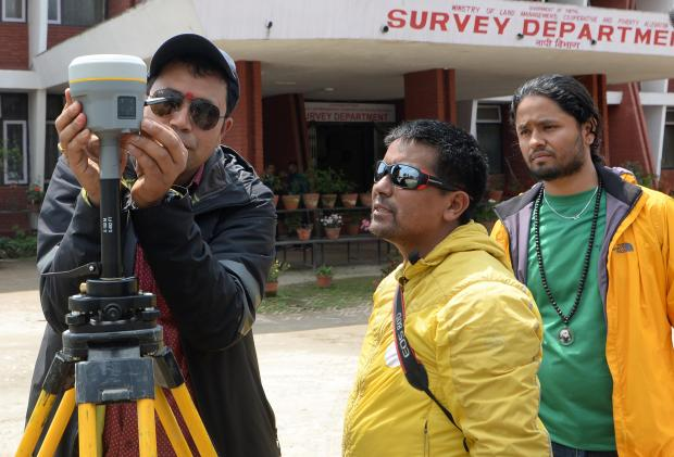 Nepali survey chief Khim Lal Gautam (L)along with his team, Suraj Sing Bhandari(2R), Yubaraj Dhital (R) and Mountain Guide Tshiring Janbu Sherpa (2L) check the equipments before leaving on an expedition to remeasure the height of Mount Everest.